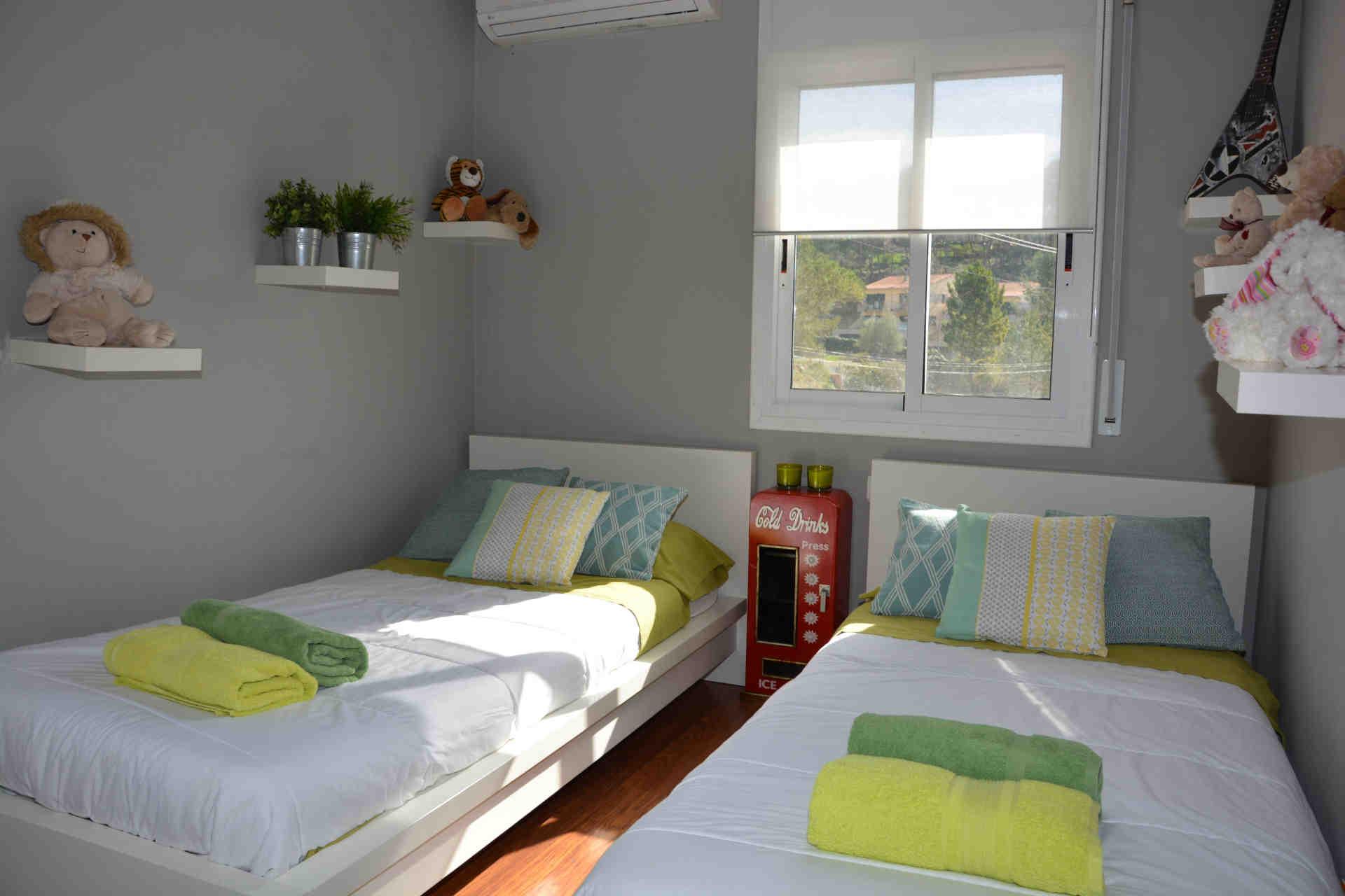 Tercera habitación doble en el chalet para vacaciones con camas individuales