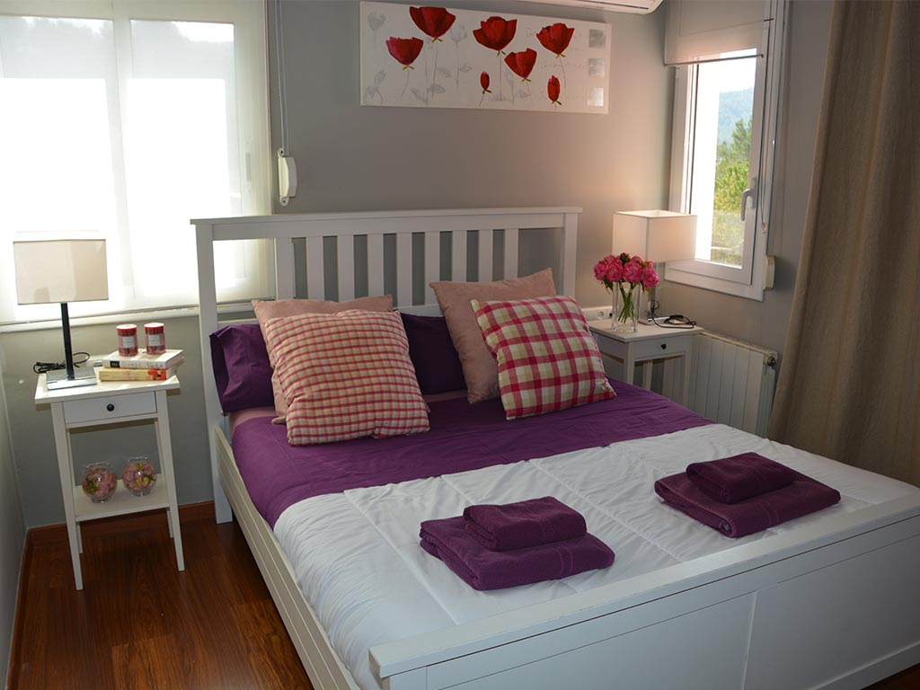 holiday villas in sitges and their bedroom with double bed