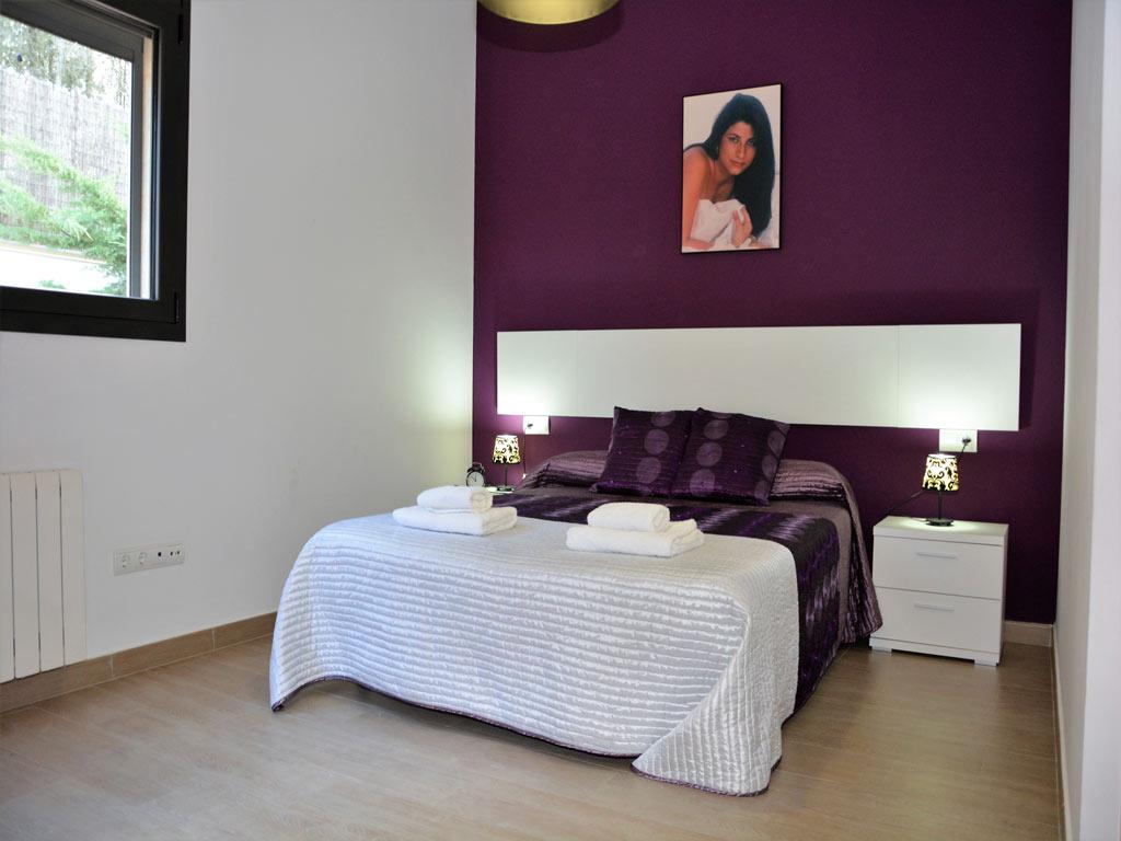 Villa Sitges con cama matrimonial.