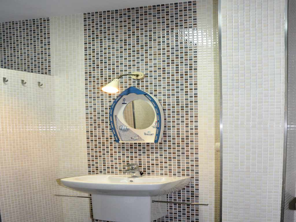 villa in Sitges with a bathroom with mirror.