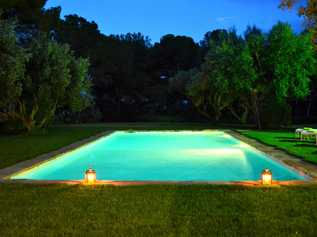 the pool of the spanish farmhouse by night