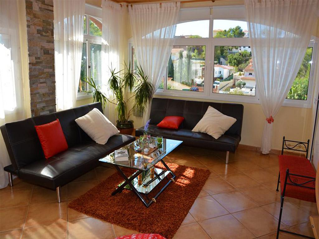 Location de vacances à barcelone: coin avec sofas