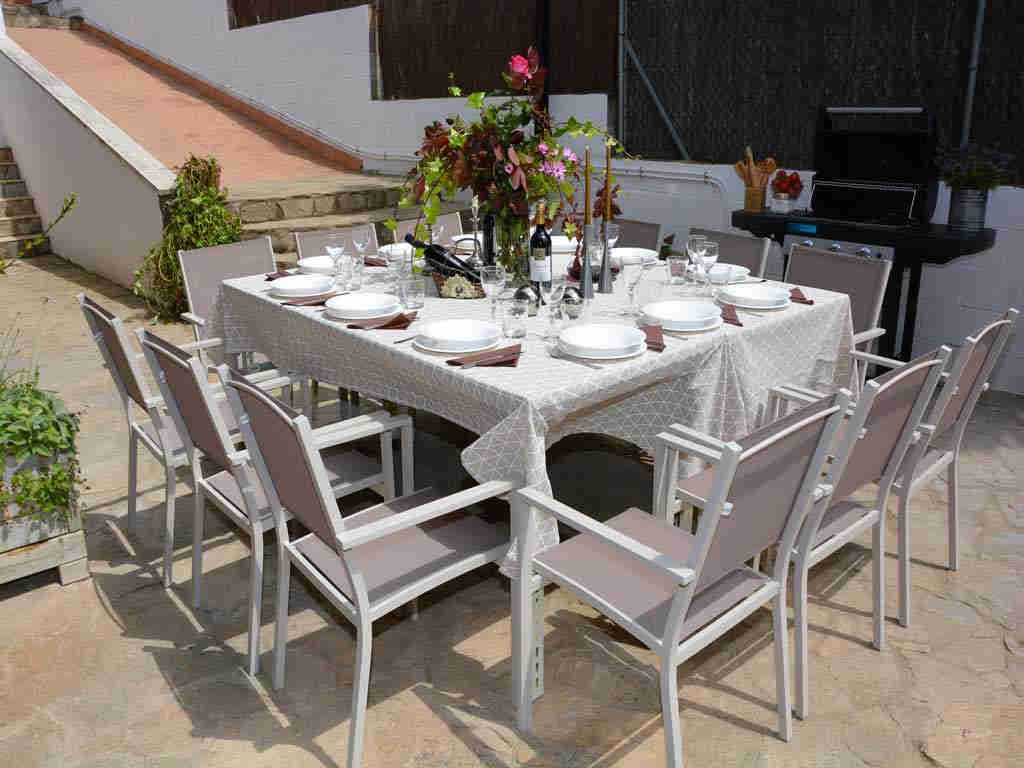 sitges villa with outdoor table to eat.
