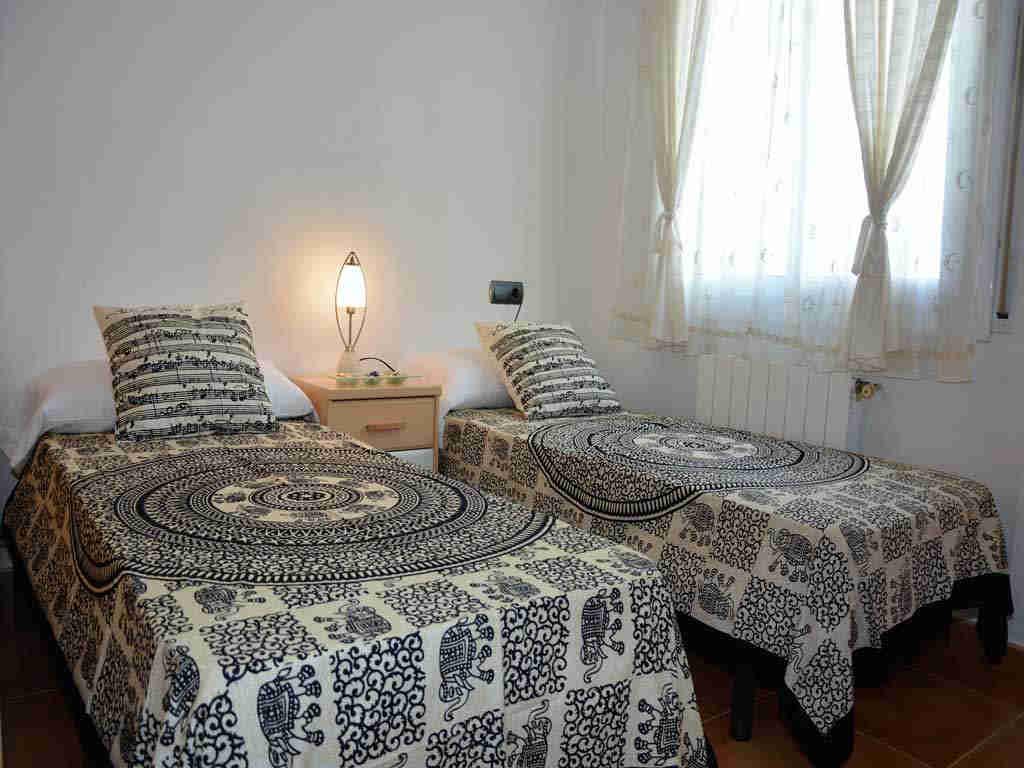 Villa en Sitges con camas individuales.