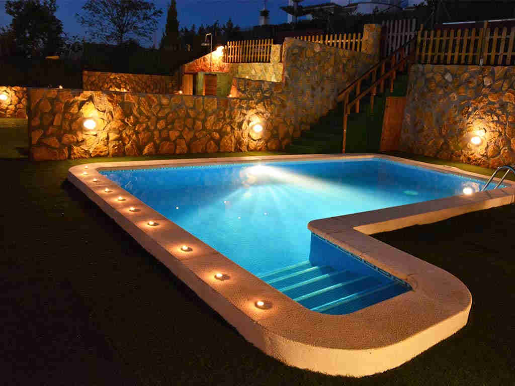 Sitges villa with 2 pools by night